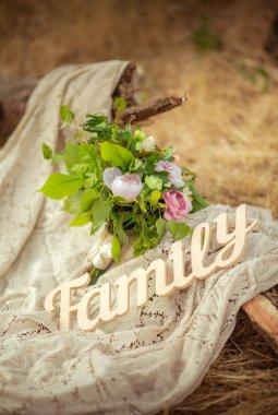Sign FAMILY with flowers