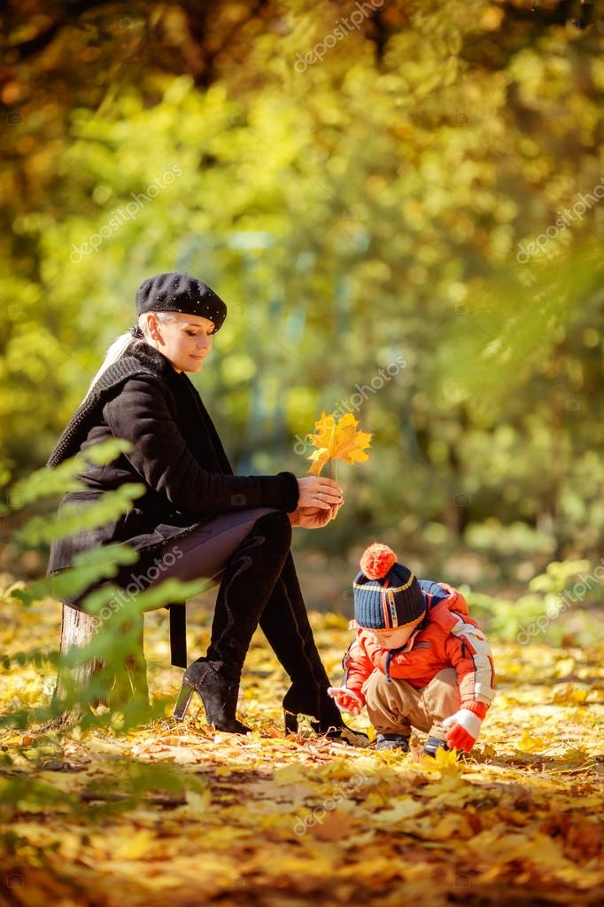 Mother and son in autumn park