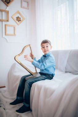 portrait of boy with harp
