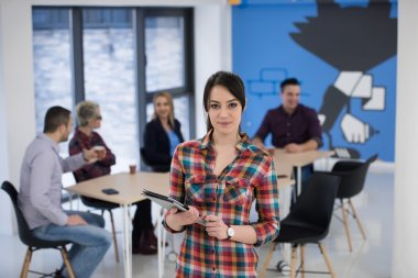 portrait of young business woman at office
