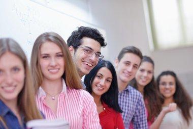 Happy teens group in school
