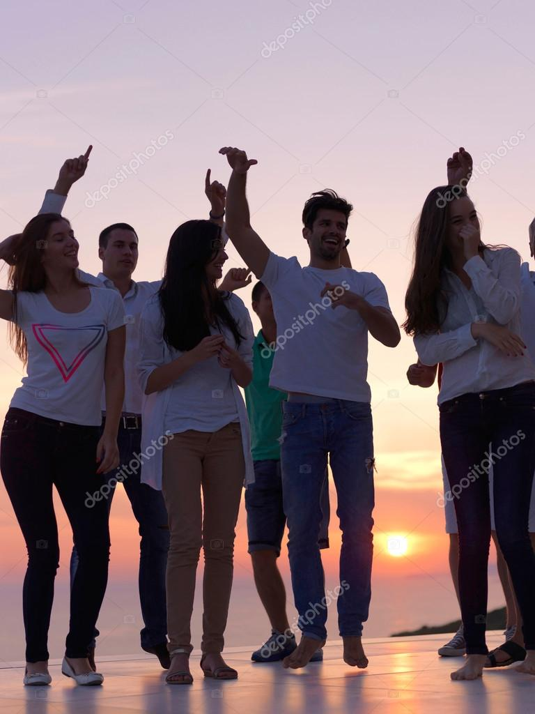 Party people at sunset