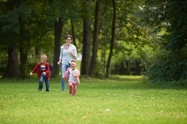 Happy family together outdoor in park