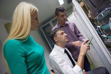Network engineers working in server room
