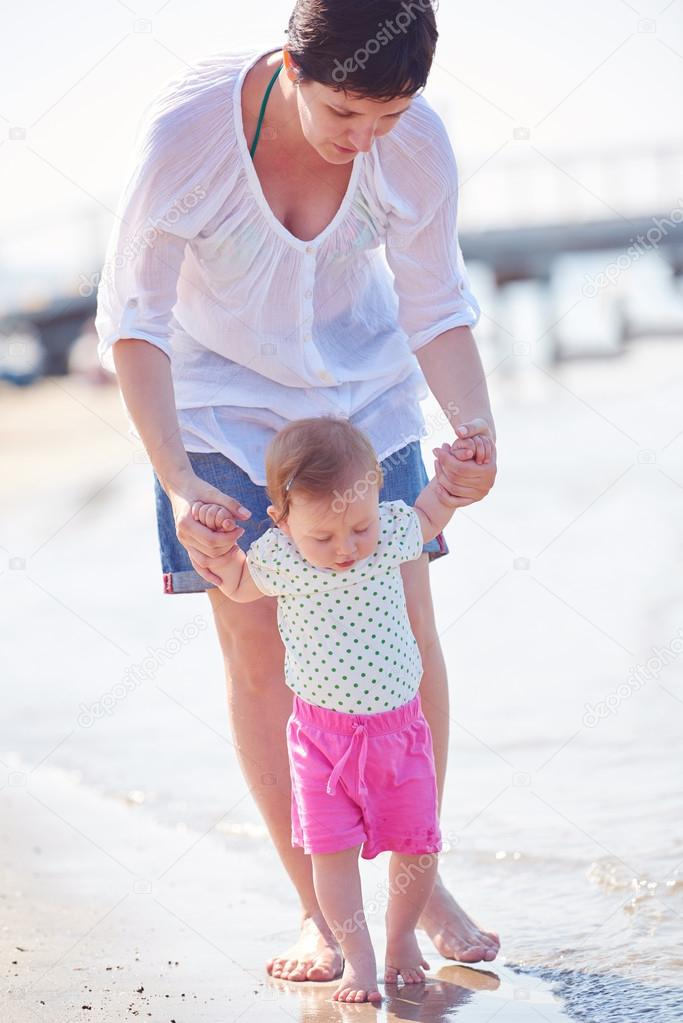 mom and baby on beach