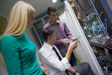 network engeneers working in network server room