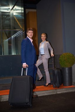 business people couple entering  hotel