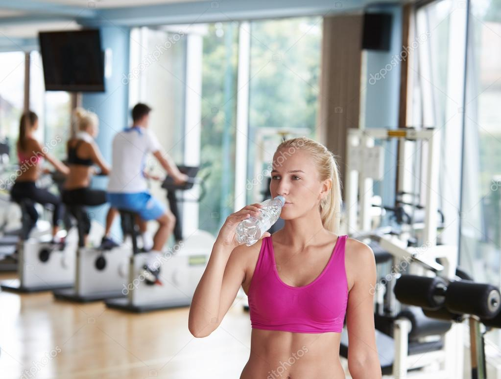 Woman in fitness gym drink water stock photo ock 87424624 woman in fitness gym drink water stock photo 87424624 sciox Gallery