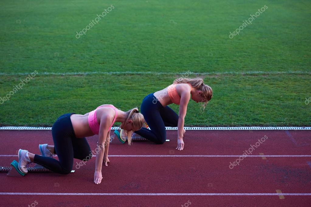 Athlete Woman Group Running On Athletics Race Track Soccer Stadium And Representing Competition Leadership Concept In Sport Photo By Shock