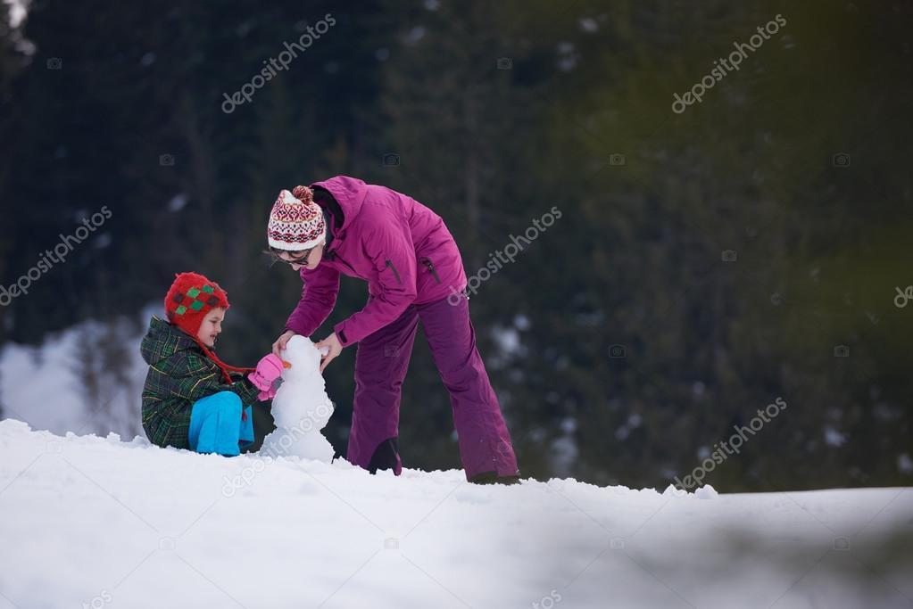 happy family building snowman