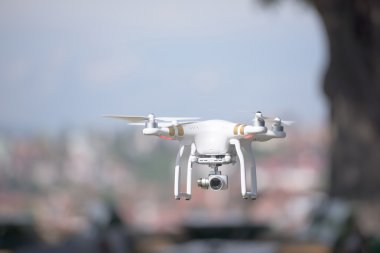 quadcopter  drone flying over the city