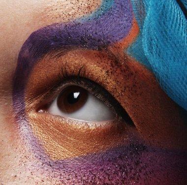 female eye with bright creative make-up