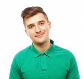 Fotografie schöner Mann im leeren grünen t-shirt