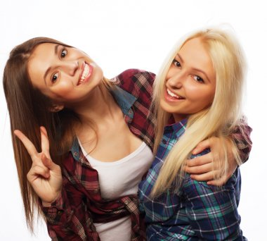 two young girl friends standing together and having fun