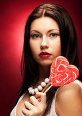Fotografie Hübsche junge Frau mit Lolli pop