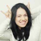 Fotografie Funny woman doing hand sign