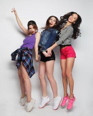 young girls friends dancing of joy in full length