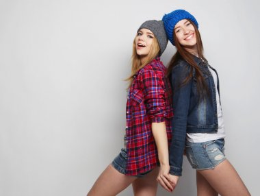 two stylish sexy hipster girls best friends