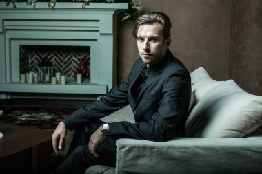 Businessman sitting on an armchair. Fahion man. stock vector