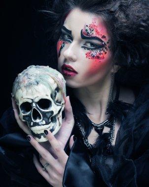 fantasy woman with skull. Halloween theme.