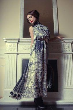 Beautiful woman portrait in classic interior.