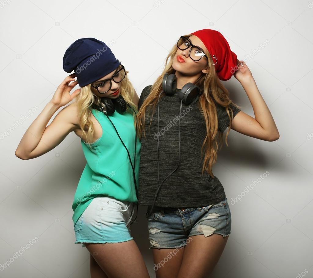 b457a8b71b3 Studio lifestyle portrait of two best friends hipster girls wearing stylish  bright outfits