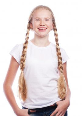 Portrait of a beautiful European blonde girl with braids.