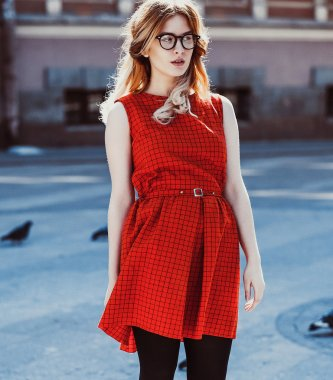 Young hipster woman wearing red dress