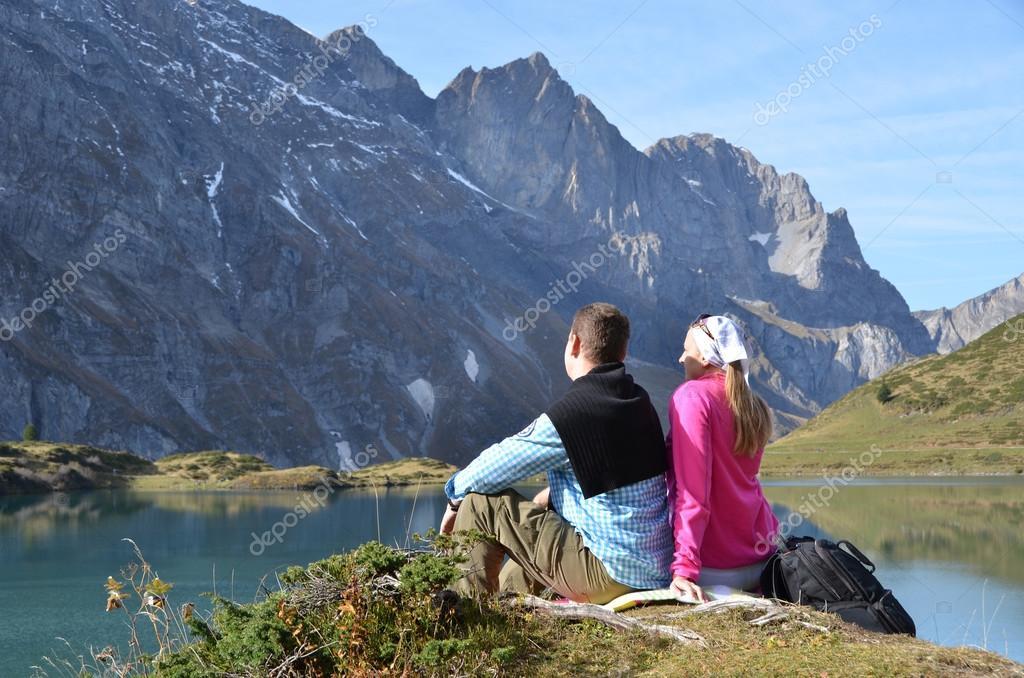 Travelers enjoying alpine view.