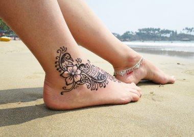 Henna tattoo on  feet in India
