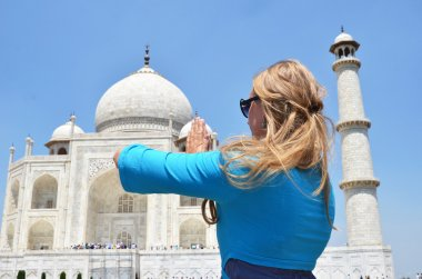 Woman meditating at Taj Mahal.