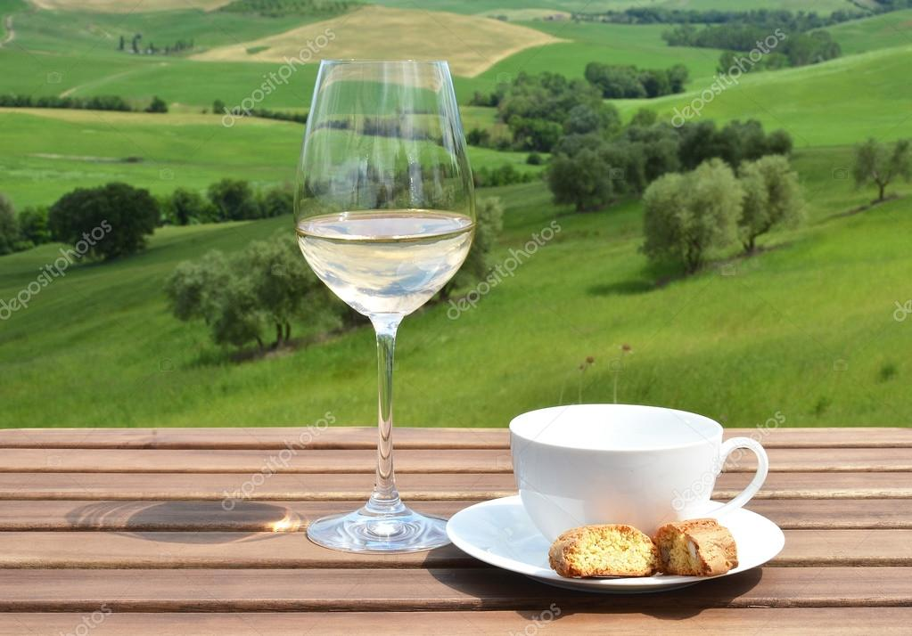 Coffee cup, cantuccini and white wine