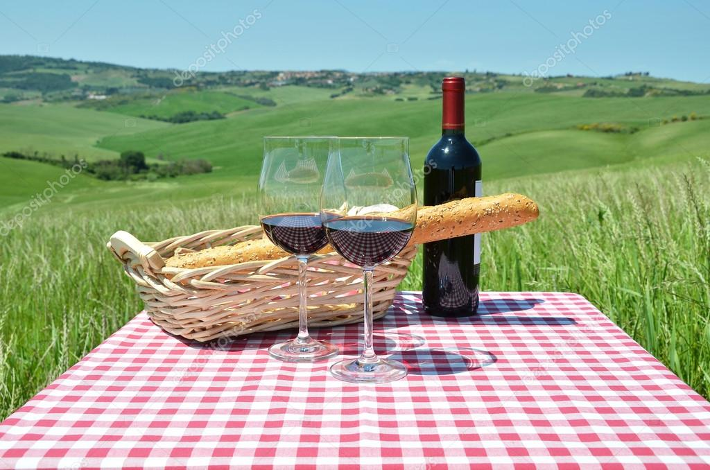 Red wine on Tuscan landscape.