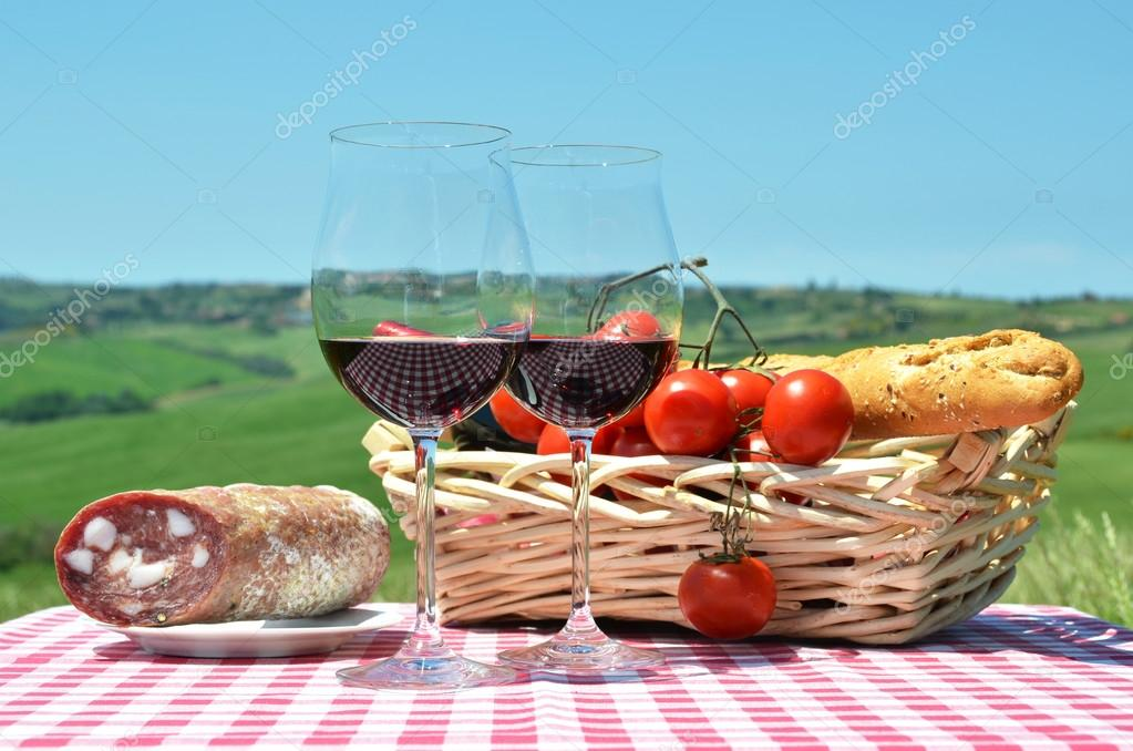 Red wine and tomatoes  against Tuscan