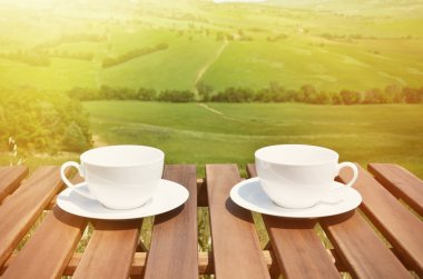 Coffee on the table against Tuscan landscape. Italy stock vector
