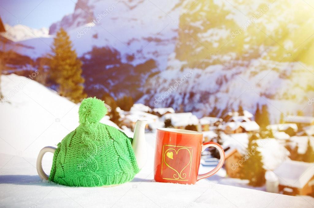 Tea pot in  cap and  cup