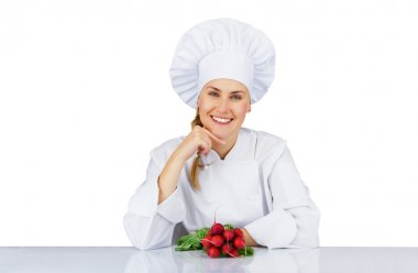 Chef woman. Isolated over white background by the table with veg