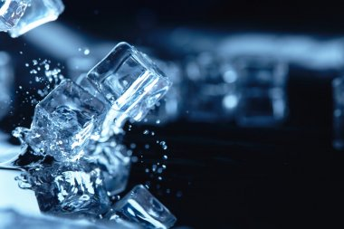 ice cubes with water splashes