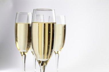 Champagne glasses on white
