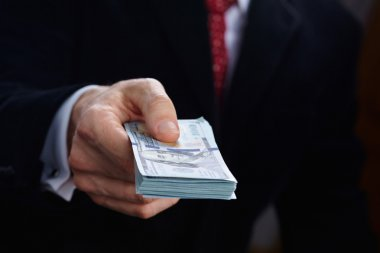 Businessman holding banknotes