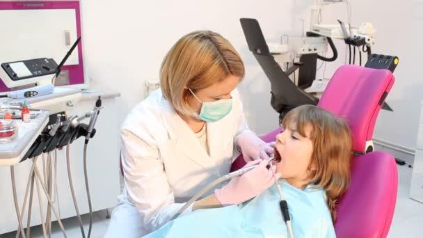 Little girl and female dentist