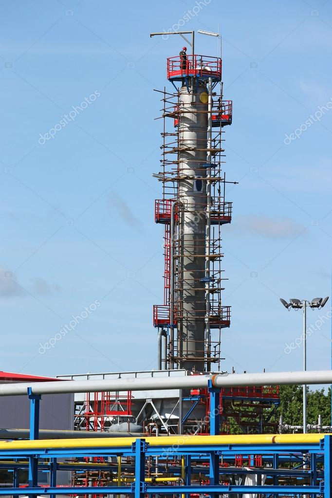 petrochemical plant construction site with worker — Stock