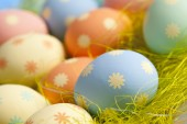 Fotografie Painted Easter eggs in nest