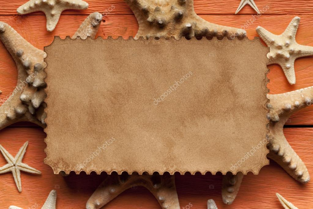 Blank paper sheet and starfish on wooden background
