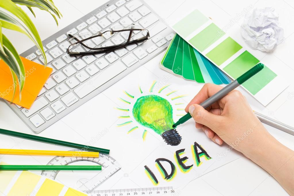 Light Bulb Drawing Designs Designer Drawing A Light Bulb Brainstorming Cocnept Stock Photo C Redpixel 79400036