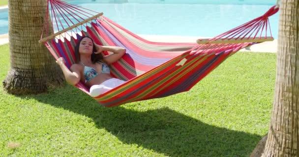 young woman in colorful hammock  u2014 stock video  118694772 woman laying down in hammock  u2014 stock video    dashek  118695070  rh   depositphotos