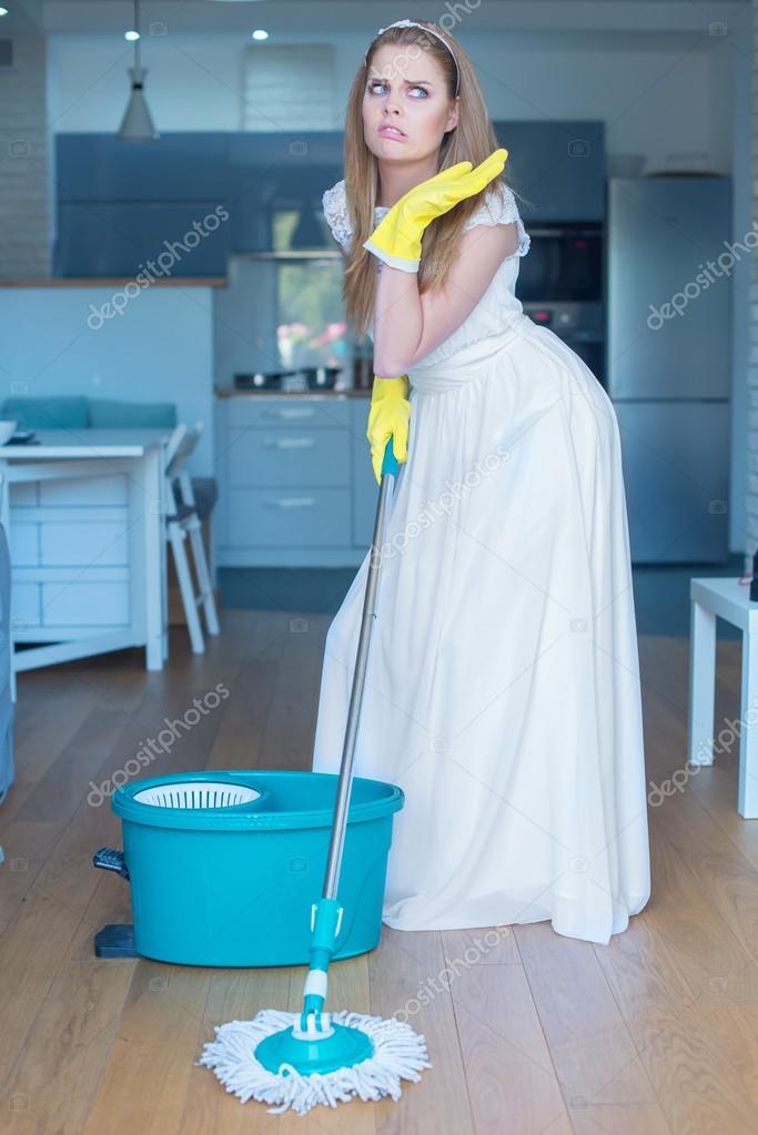Qué estará haciendo ahora...? Depositphotos_53079571-stock-photo-woman-wearing-gown-mopping-floor