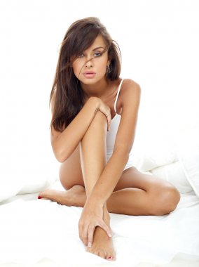 Seductive Woman Sitting on  Bed