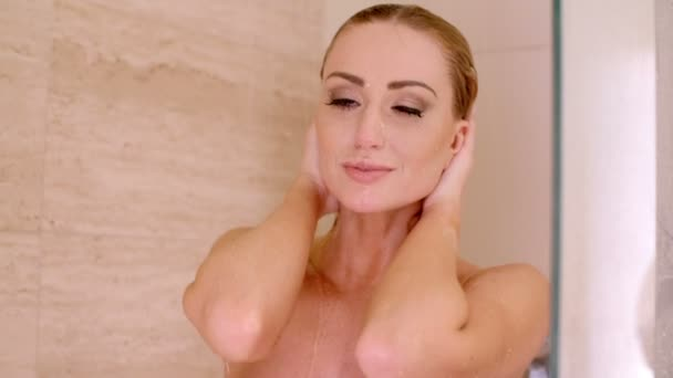 Naked Young Woman Under a Shower