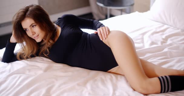 Adorable and Pretty Young Girl Lying on Bed